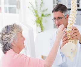 Doctor Explaining Spine Procedure